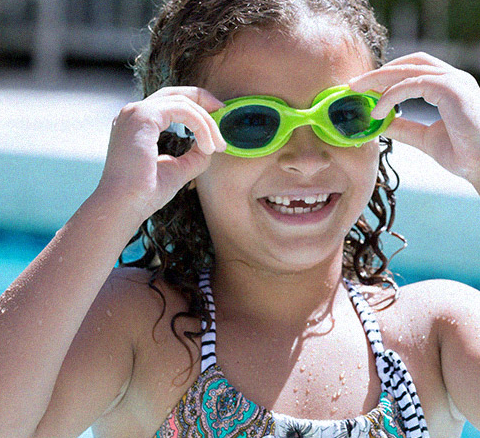 Girl in pool with green goggles